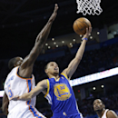 Golden State Warriors guard Stephen Curry (30) shoots between Oklahoma City Thunder center Kendrick Perkins (5) and forward Kevin Durant (35) in the first quarter of an NBA basketball game in Oklahoma City, Friday, Nov. 29, 2013 The Associated Press