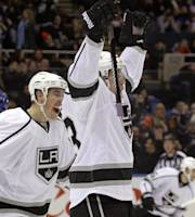 Los Angeles Kings center Tyler Toffoli, right, and Kings left wing Tanner Pearson (70) celebrate after Toffoli scored the go-ahead goal in the Kings' 3-2 victory over the New York Islanders in the third period of an NHL hockey game at Nassau Coliseum in Uniondale, N.Y., Thursday, Nov. 14, 2013. (AP Photo/Kathy Willens)