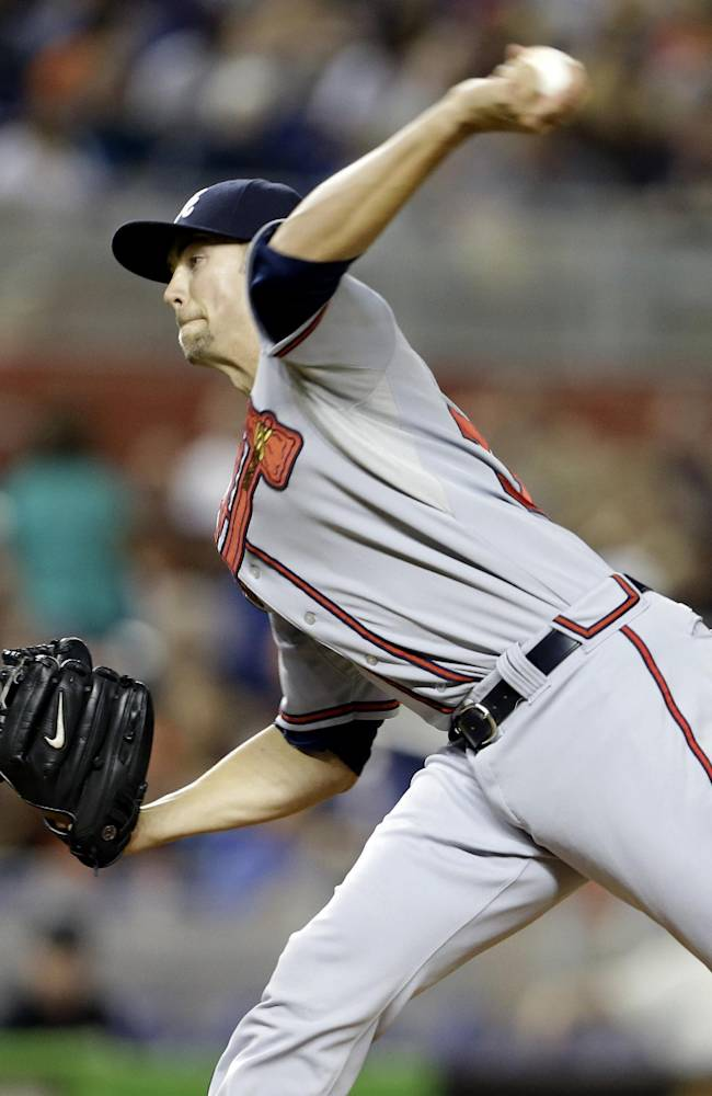 Atlanta Braves starting pitcher Mike Minor throws in the first inning during a baseball game against the Miami Marlins, Wednesday, Sept. 11, 2013, in Miami