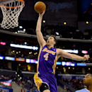 Los Angeles Lakers forward Ryan Kelly (4) goes up for a dunk as Los Angeles Clippers guard Willie Green, right, in the second half of an NBA basketball game, Sunday, April 6, 2014, in Los Angeles. The Clippers won 120-97 The Associated Press