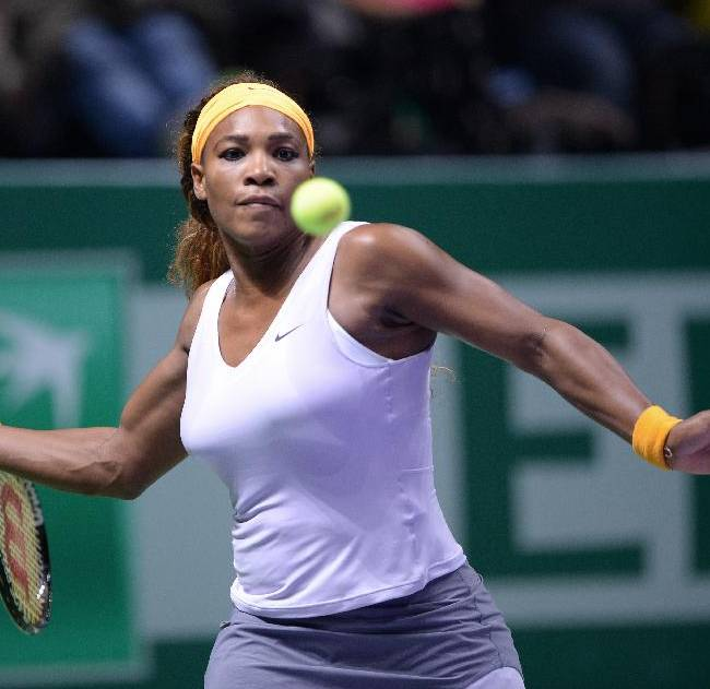Serena Williams of the USA returns a shot to Agnieszka Radwanska of Poland during their tennis match at the WTA championship in Istanbul, Turkey, Wednesday, Oct. 23, 2013. The world's top female tennis players compete in the championships which runs from Oct. 22 until Oct. 27. (AP Photo)