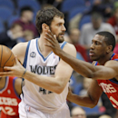 Minnesota Timberwolves forward Kevin Love, left, looks to drive against Philadelphia 76ers forward Thaddeus Young, right, during the first quarter of an NBA basketball game in Minneapolis, Wednesday, Dec. 11, 2013. (AP Photo/Ann Heisenfelt)