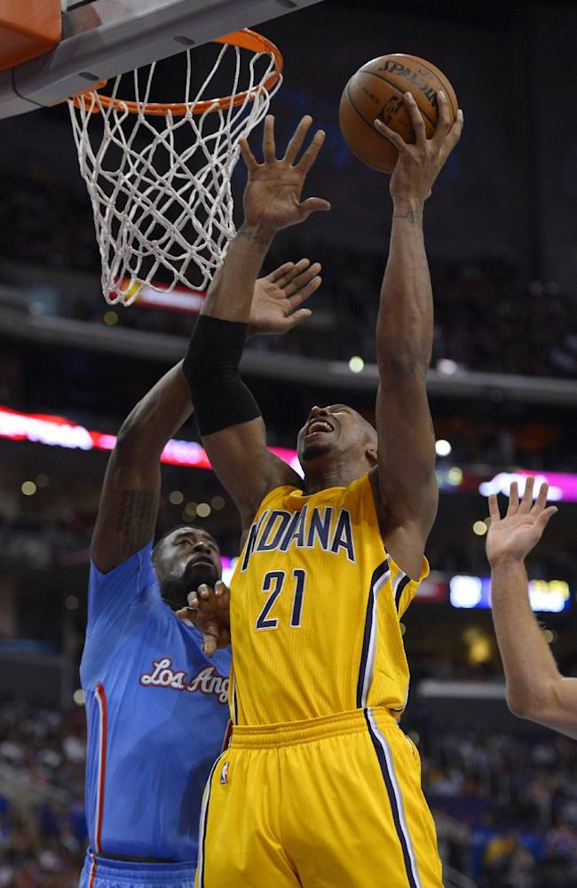 Indiana Pacers forward David West, right, puts up a shot as Los Angeles Clippers center DeAndre Jordan defends during the first half of an NBA basketball game, Sunday, Dec. 1, 2013, in Los Angeles