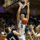 Duke's Mason Plumlee (5) dunks over Western Washington's Cameron Severson (13) during the second half of an NCAA preseason college basketball game on Saturday, Oct. 27, 2012 in Durham, N.C. Plumlee had 22 points and Duke won 105-87. (AP Photo/Ted Richardson)