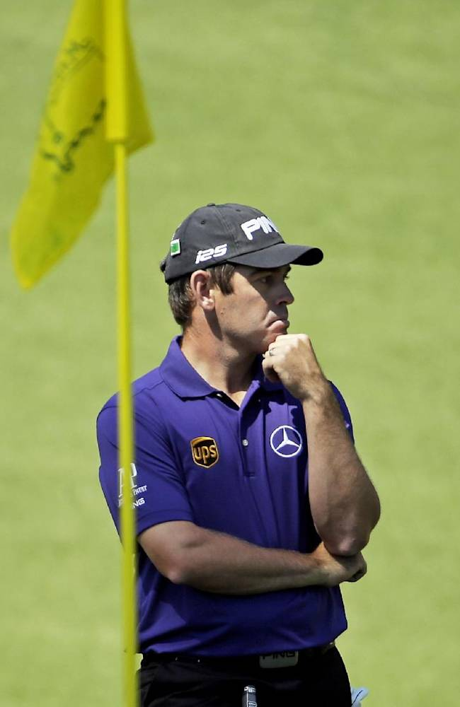 Louis Oosthuizen, of South Africa, waits to putt on the 10th green during the first round of the Masters golf tournament Thursday, April 10, 2014, in Augusta, Ga