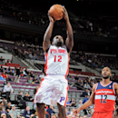 AUBURN HILLS, MI - FEBRUARY 13: Will Bynum #12 of the Detroit Pistons drives to the basket against the Washington Wizards on February 13, 2013 at The Palace of Auburn Hills in Auburn Hills, Michigan. (Photo by Allen Einstein/NBAE via Getty Images)