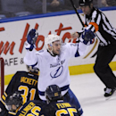 Tampa Bay Lightning' Ryan Callahan, center, celebrates his tying goal, as Buffalo Sabres' Matt Hackett (31) Henrik Tallinder (20) and Matt Flynn (65) react during the third period of an NHL hockey game in Buffalo, N.Y., Saturday, March 29, 2014. Tampa Ba