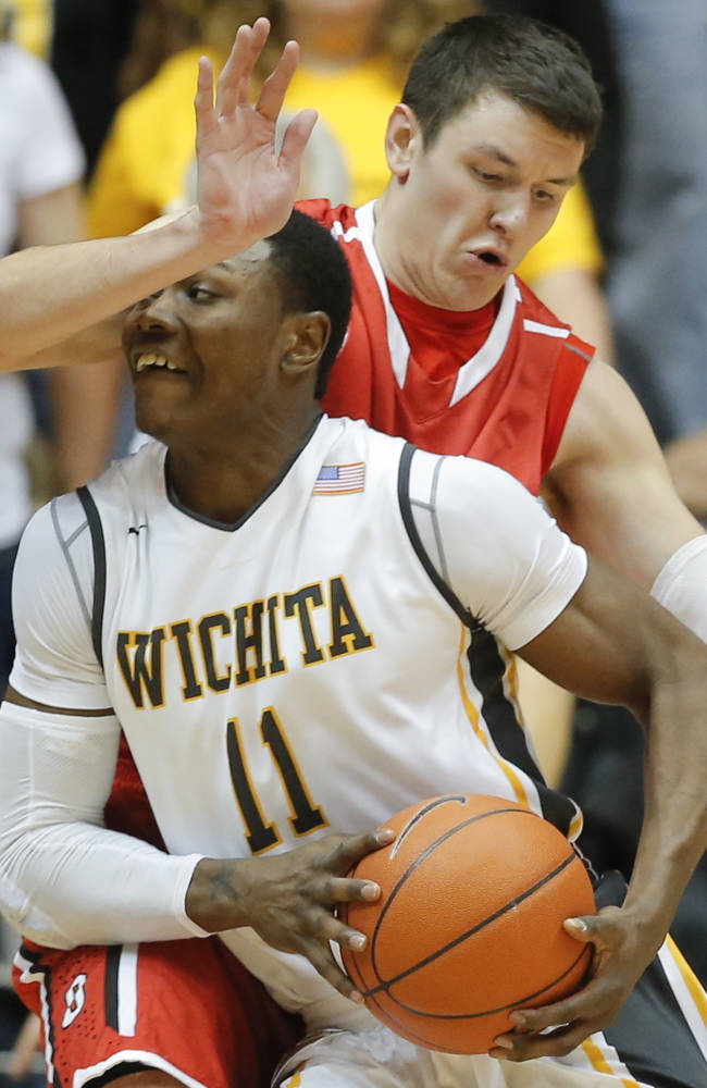 Wichita State's Cleanthony Early is fouled by Davidson's Andrew McAuliffe during the first half of an NCAA college basketball game Sunday, Dec. 29, 2013 at Koch Arena in Wichita, Kan. Wichita State defeated Davidson 81-70