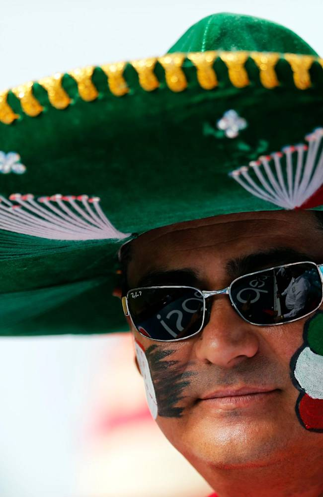 A fan of the Mexican baseball team listens the Mexican national anthem prior a Caribbean Series baseball game against Dominican Republic in Porlamar, Venezuela, Wednesday, Feb. 5, 2014