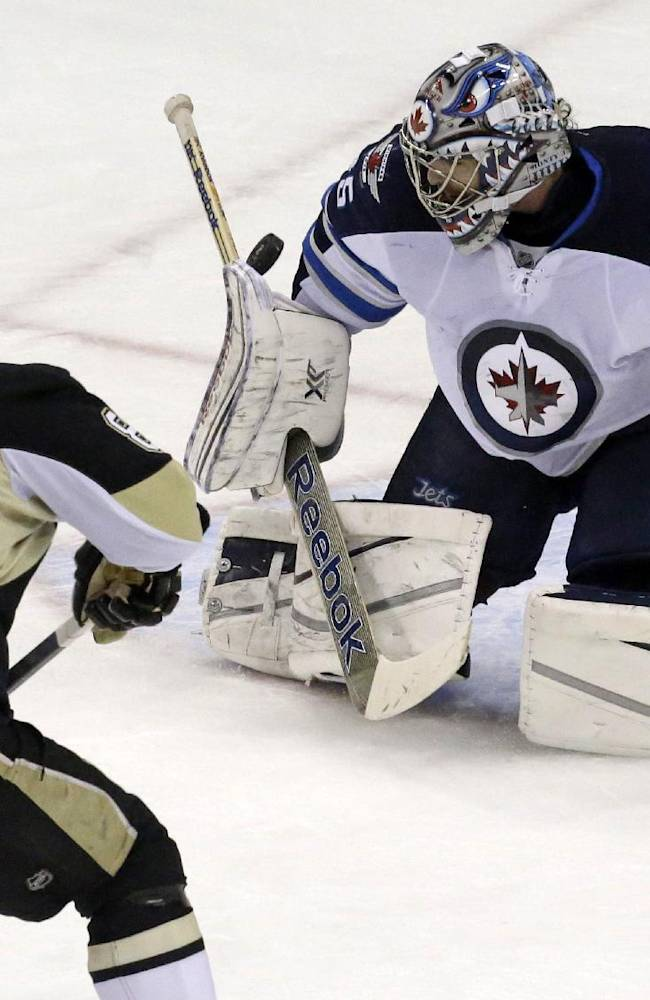Pittsburgh Penguins' Sidney Crosby (87) shoots wide and misses on Winnipeg Jets goalie Al Montoya (35) on a first-period penalty shot during an NHL hockey game in Pittsburgh, Sunday, Jan. 5, 2014
