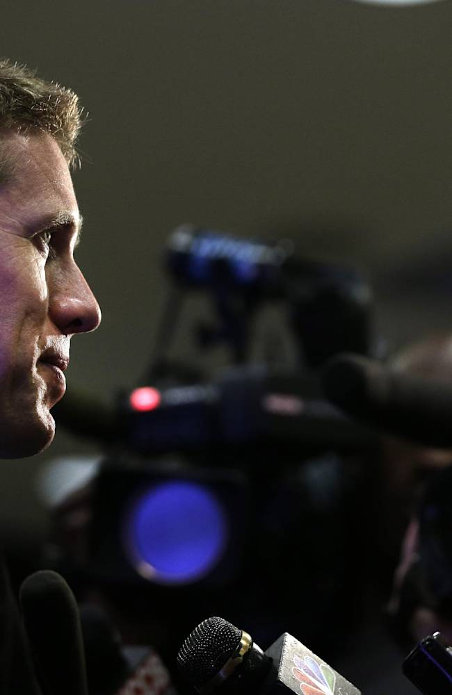 Carl Edwards answers a question during a news conference at Joe Gibbs Racing's headquarters in Huntersville, N.C., Tuesday, Aug. 19, 2014. Joe Gibbs Racing has hired Carl Edwards to drive a new fourth Sprint Cup car in 2015 and Daniel Suarez will drive in the Nationwide series