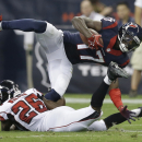 Houston Texans' Uzoma Nwachukwu (17) is upended by Atlanta Falcons' Josh Wilson (26) during the third quarter of an NFL preseason football game Saturday, Aug. 16, 2014, in Houston The Associated Press