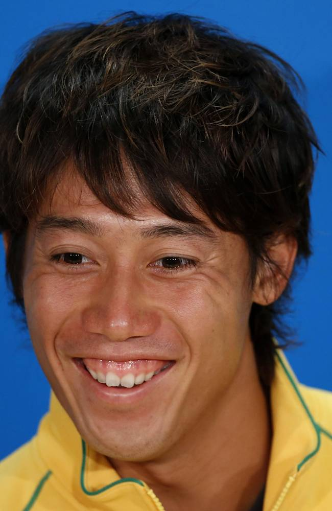 CORRECTS DATE - Japan's Kei Nishikori smiles during a press conference at the Australian Open tennis championship in Melbourne, Australia, Sunday, Jan. 12, 2014