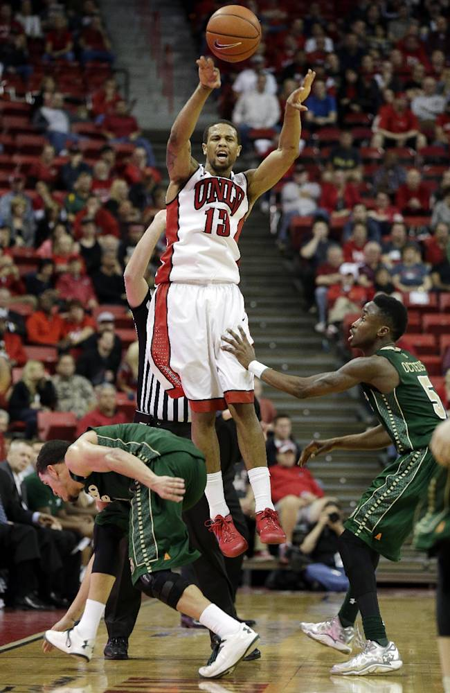 UNLV's Bryce Dejean-Jones passes over the Colorado State defense during the second half of an NCAA college basketball game on Wednesday, Feb. 26, 2014, in Las Vegas. UNLV defeated Colorado State 78-70