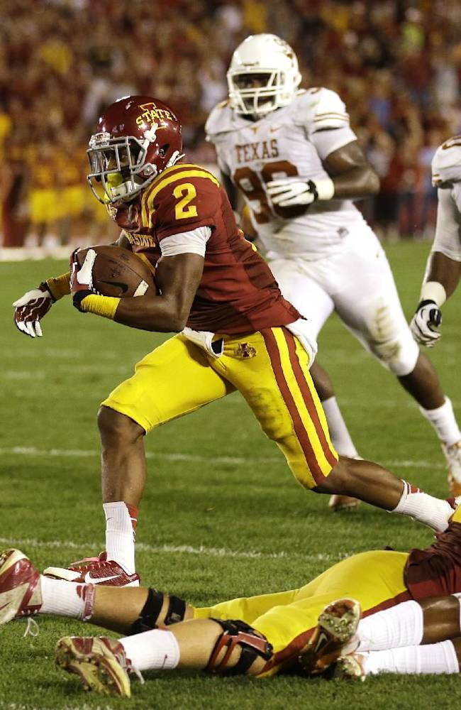 Iowa State's Aaron Wimberly (2) runs to the end zone past Texas defenders during an 11-yard touchdown reception in the first half of an NCAA college football game, Thursday, Oct. 3, 2013, in Ames, Iowa
