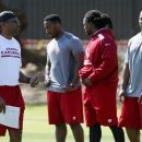 From left to right, former Olympic champion and Arizona Cardinals new assistant strength and conditioning coach Roger Kingdom, instructs Cardinals players Stepfan Taylor, Robert Hughes and Jonathan Dwyer during the first phase of the voluntary offseason