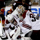 Arizona Coyotes goalie Louis Domingue blocks a shot as Jordan Martinook watches during the second period of an NHL hockey preseason game against the Anaheim Ducks in Anaheim, Calif., Tuesday, Sept. 23, 2014. The Associated Press