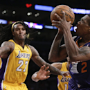 Phoenix Suns guard Eric Bledsoe, right, shoots over Los Angeles Lakers center Jordan Hill during the second half of an NBA basketball game in Los Angeles, Tuesday, Dec. 10, 2013 The Associated Press