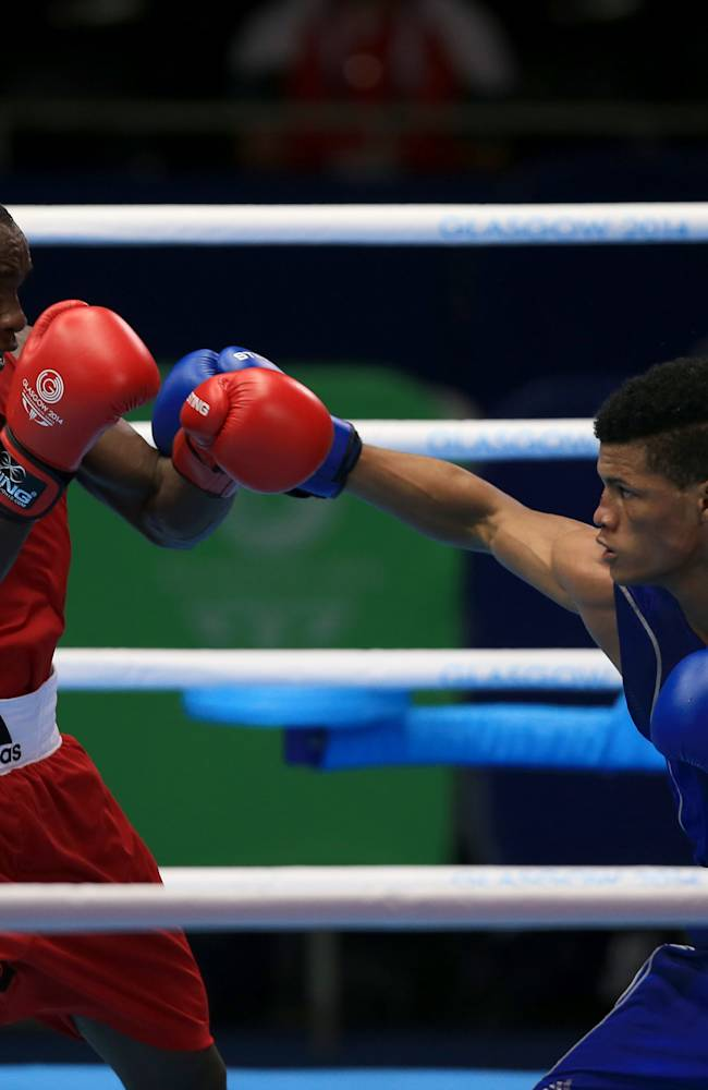 Trinidad and Tobago's Michael Alexander, right, in action against Nigeria's Oto Joseph in the Men's Light (75kg) Round of the 32 during the 2014 Commonwealth Games in Glasgow, Scotland, Saturday, July 26, 2014