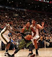 TORONTO, CANADA - November 9: DeMar DeRozan #10 of the Toronto Raptors drives to the basket against Enes Kanter #0 of the Utah Jazz on November 9, 2013 at the Air Canada Centre in Toronto, Ontario, Canada. (Photo by Ron Turenne/NBAE via Getty Images)
