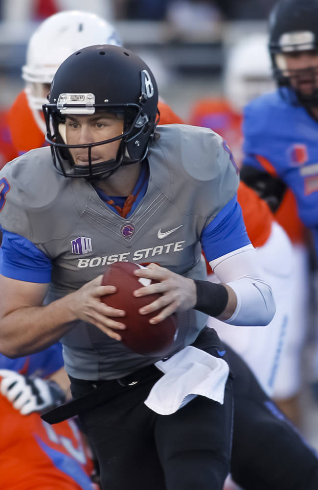 Boise State quarterback Thomas Stuart runs the ball during the second half of an NCAA college spring football scrimmage in Boise, Idaho, Saturday, April 12, 2014