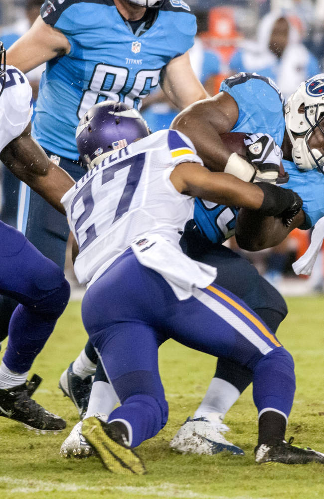 Tennessee Titans running back Antonio Andrews is tackled by Minnesota Vikings corner back Shaun Prater during the Titans' 19-3 preseason loss to the Vikings at LP Field on Thursday, Aug. 28, 2014
