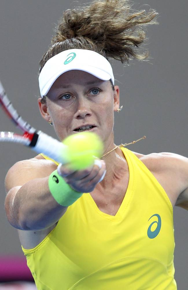 Samantha Stosur of Australia plays a shot during her match against Andrea Petkovic of Germany during their Fed Cup semifinal match between Australia and Germany in Brisbane, Australia, Saturday, April 19, 2014