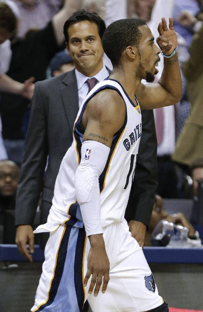 Memphis Grizzlies guard Mike Conley walks past Miami Heat head coach Erik Spoelstra as Conley celebrates after making a 3-point basket in the second half of an NBA basketball game Wednesday, April 9, 2014, in Memphis, Tenn. The Grizzlies won 107-102