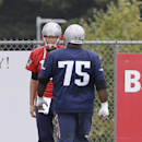 New England Patriots defensive tackle Vince Wilfork (75) talks with quarterback Tom Brady (12) during a stretching session before practice begins at the NFL football team's facility Thursday, Sept. 11, 2014, in Foxborough, Mass The Associated Press