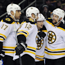 Boston Bruins' Milan Lucic, Simon Gagne, Torey Krug and Dennis Seidenberg celebrate a goal by Krug during the second period of an NHL hockey game against the Buffalo Sabres in Buffalo, N.Y., Saturday, Oct. 18, 2014 The Associated Press