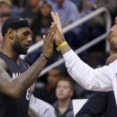 Miami Heat's LeBron James, left, gets a high-five from teammate Michael Beasley during the first half of an NBA basketball game against the Phoenix Suns on Tuesday, Feb. 11, 2014, in Phoenix The Associated Press