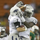 Nevada defensive back Duran Workman (7) celebrates with teammate Lenny Jones (94) after Workman made an interception during the 4th quarter of the NCAA college football game against Hawaii, Saturday, Oct. 25, 2014, in Honolulu. Nevada defeated Hawaii 26-