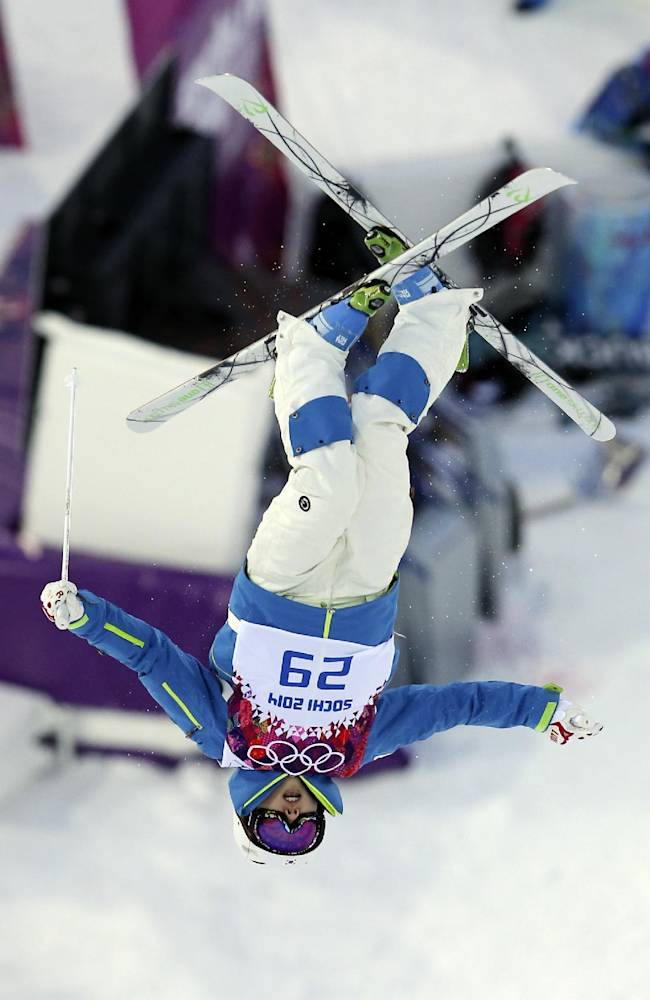 South Korea's Seo Jung-hwa jumps during the women's moguls qualifying at the Rosa Khutor Extreme Park, at the 2014 Winter Olympics, Saturday, Feb. 8, 2014, in Krasnaya Polyana, Russia