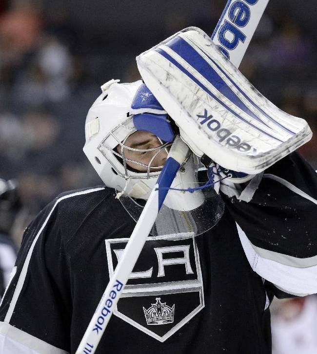 Los Angeles Kings goalie Mathieu Garon reacts after the Phoenix Coyotes score the fifth during the third period of an NHL hockey game at the Staples Center Sunday, April 15, 2013., in Los Angeles