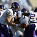 East Carolina quarterback Shane Carden (5)hands off to Reggie Bullock (28) during the first half of an NCAA college football game in Chapel Hill, N.C., Saturday, Sept. 22, 2012. (AP Photo/Gerry Broome)