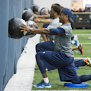A photo provided by the Denver Broncos is of Broncos cornerback Aqib Talib, front, working out with teammates during the first phase of the offseason training program at the NFL football teams training facility in Englewood, Colo., on Monday, April 21, 20
