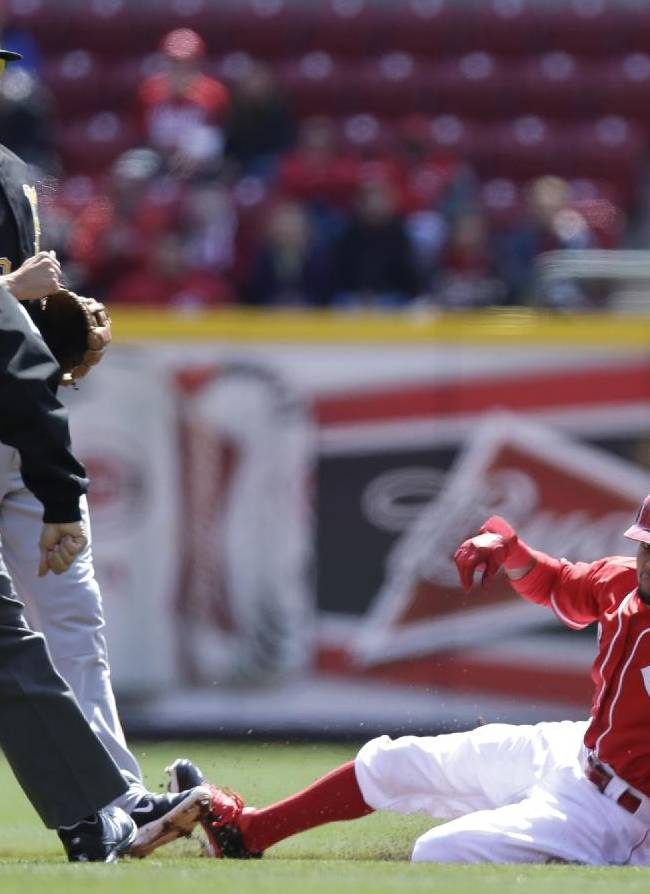 Cincinnati Reds' Billy Hamilton, right, steals second base as Pittsburgh Pirates second baseman Neil Walker waits for the ball in the first inning of a baseball game, Wednesday, April 16, 2014, in Cincinnati