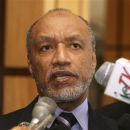FILE - A Tuesday, May 10, 2011 photo from files shows Mohamed bin Hammam, chief of the Asian Football Confederation, as he talks to local media in Port of Spain, Trinidad &#038; Tobago. Former FIFA presidential candidate Mohamed bin Hammam has won his case against a life ban from football for allegedly bribing voters during his challenge to Sepp Blatter. However, the Court of Arbitration for Sport says its panel upheld bin Hammam's appeal because of lack of evidence _ and was not convinced he is innocent of corruption. Still, the CAS ruling overturns FIFA verdicts which had exiled the 63-year-old Qatari.  (AP Photo/Shirley Bahadur, File)