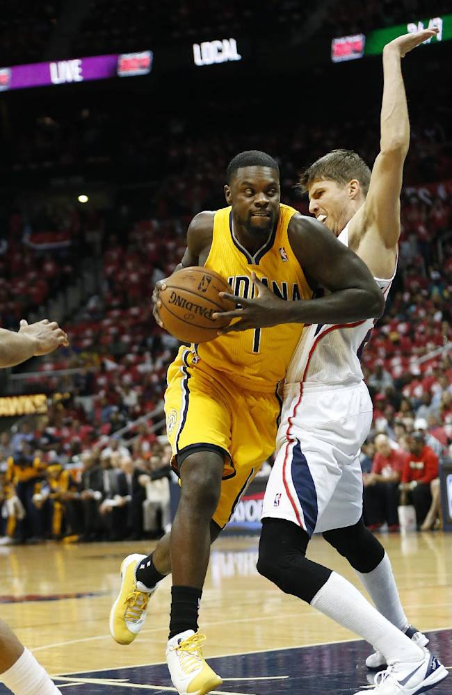 Indiana Pacers guard Lance Stephenson (1) drives against Atlanta Hawks guard Kyle Korver (26) in the first half of Game 6 of a first-round NBA basketball playoff series in Atlanta, Thursday, May 1, 2014