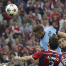 Manchester City's Edin Dzeko, rear, heads the ball during the Champions League group E soccer match between Bayern Munich and Manchester City in Munich, Germany, Wednesday Sept.17,2014