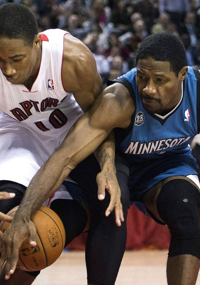 Toronto Raptors forward DeMar DeRozan, left, battles for the ball against Minnesota Timberwolves forward Othyus Jeffers, right, during the first half of an NBA preseason basketball game in Toronto on Wednesday, Oct. 9, 2013
