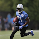Detroit Lions running back Reggie Bush runs the ball during NFL football training camp in Allen Park, Mich., Tuesday, July 29, 2014 The Associated Press