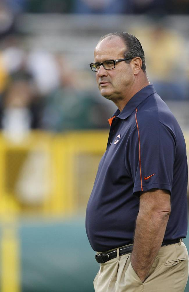 In this Sept. 13, 2012 file photo, Chicago Bears offensive coordinator Mike Tice walks on the field before an NFL football game against the Green Bay Packers, in Green Bay, Wis. The Atlanta Falcons say Tice will become their new offensive line coach. The team announced the move Wednesday, Jan. 8, 2014