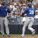 Toronto Blue Jays' Chris Getz, left, greets teammate Colby Rasmus (28) who scored on Ryan Goins' second-inning sacrifice bunt in a spring exhibition baseball game against the New York Yankees in Tampa, Fla., Sunday, March 23, 2014 The Associated Press