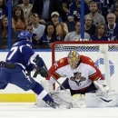 Florida Panthers goalie Jacob Markstrom (35), of Sweden, stops Tampa Bay Lightning left wing Benoit Pouliot (67) on a penalty