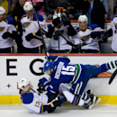 Vancouver Canucks' Brad Richardson, right, falls on St. Louis Blues' Carlo Colaiacovo after checking him to the ice during the first period of an NHL hockey game in Vancouver, British Columbia, on Wednesday, Feb. 26, 2014 The Associated Press