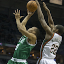 Milwaukee Bucks' John Henson tries to block the shot of Boston Celtics' Avery Crawford during the first half of an NBA basketball game Saturday, Nov. 30, 2013, in Milwaukee. (AP Photo/Tom Lynn)