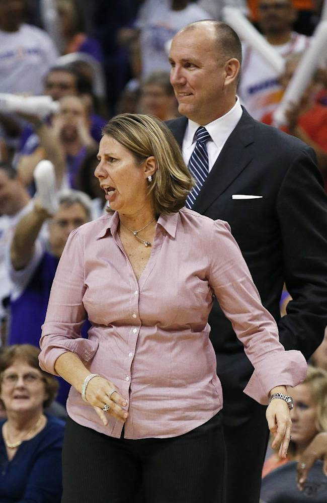 Minnesota Lynx coach Cheryl Reeve, left, shouts as she is ejected by officials, as assistant coach Jim Peterson stands behind her during the second half of Game 3 in the WNBA Western Conference basketball finals against the Phoenix Mercury on Tuesday, Sept. 2, 2014, in Phoenix. The Mercury defeated the Lynx 96-78, winning the series and advancing to the WNBA Finals