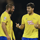 Derby's Chris Martin, right, celebrates after he scored a goal during the English League Cup soccer match between Fulham and Derby County at Craven Cottage stadium in London, Tuesday, Oct. 28, 2014