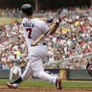 Minnesota Twins Joe Mauer (7) strikes out against Boston Red Sox starting pitcher John Lackey as Jarrod Saltalamacchia, right, catches during the sixth inning of a baseball game, Sunday, May 19, 2013, in Minneapolis. (AP Photo/Genevieve Ross)